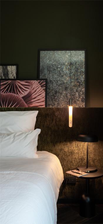 Detail eines der 25 individuell gestalteten Zimmer. Foto: Katoo Peters