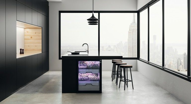 Clean_kitchen_studio_interior_with_panoramic_New_York_city_view_and_daylight._3D_Rendering_